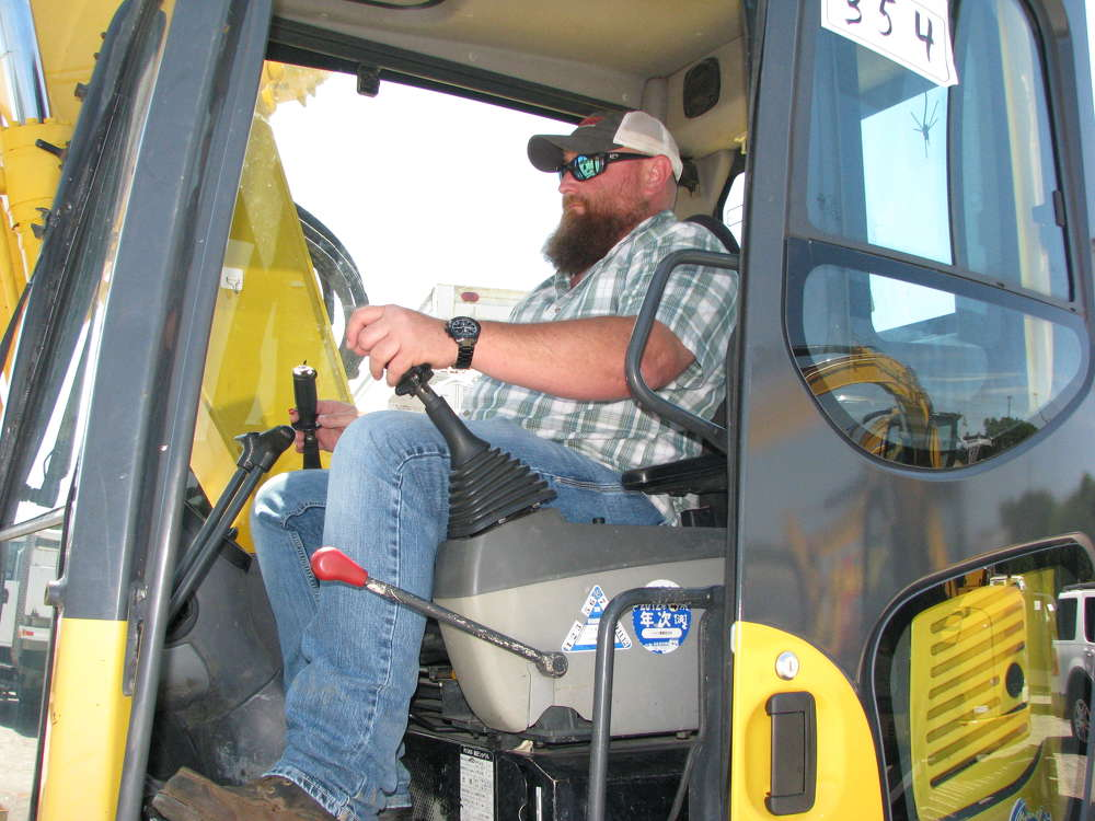 Ben Hopkins of Ben Hopkins LLC, a site prep and utilities contractor based in Jasper, Ga., tests out a Komatsu PC138US.