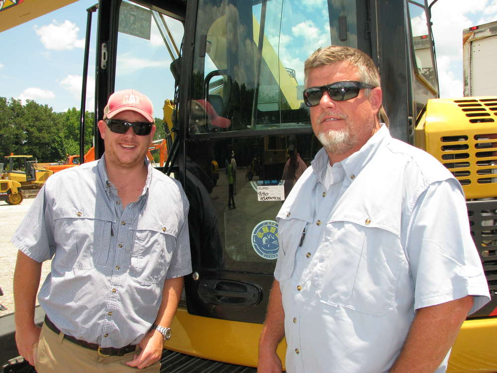 Tom Powell (L), Lowbird Outdoors, Atlanta, Ga., and Brent Beverly, BTM Machinery, Charleston, S.C., are ready for the bidding to begin.
