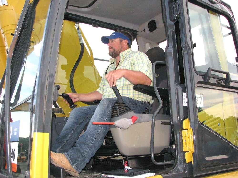 Stephen Fairley, Fairley Construction, Hattiesburg, Miss., tests out this Komatsu PC210LC excavator.