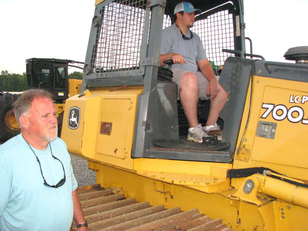 Gary (L) and Kenny Bryant, both of Gary Bryant Enterprises, Burnsville, N.C., operate this John Deere 700J LGP dozer.