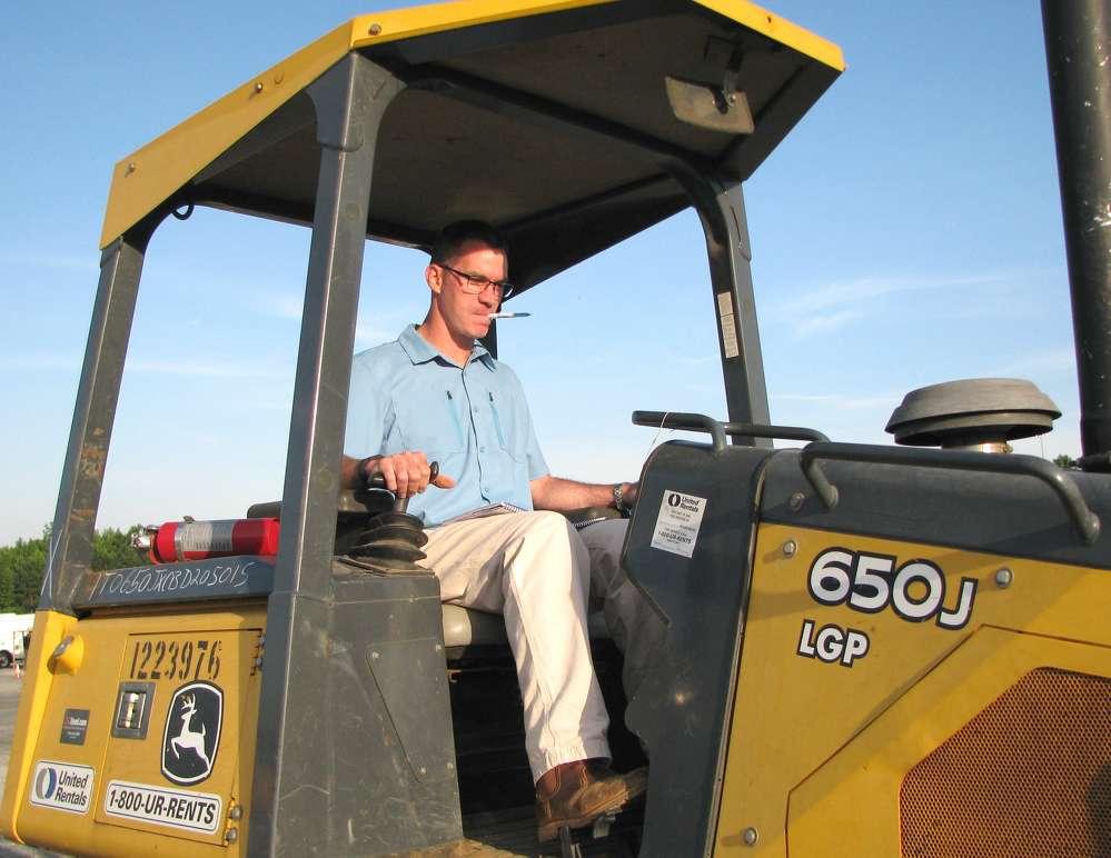 Brett Johnson of Vertical Earth, Cumming, Ga., takes one last spin on this John Deere 650J dozer before the auction.