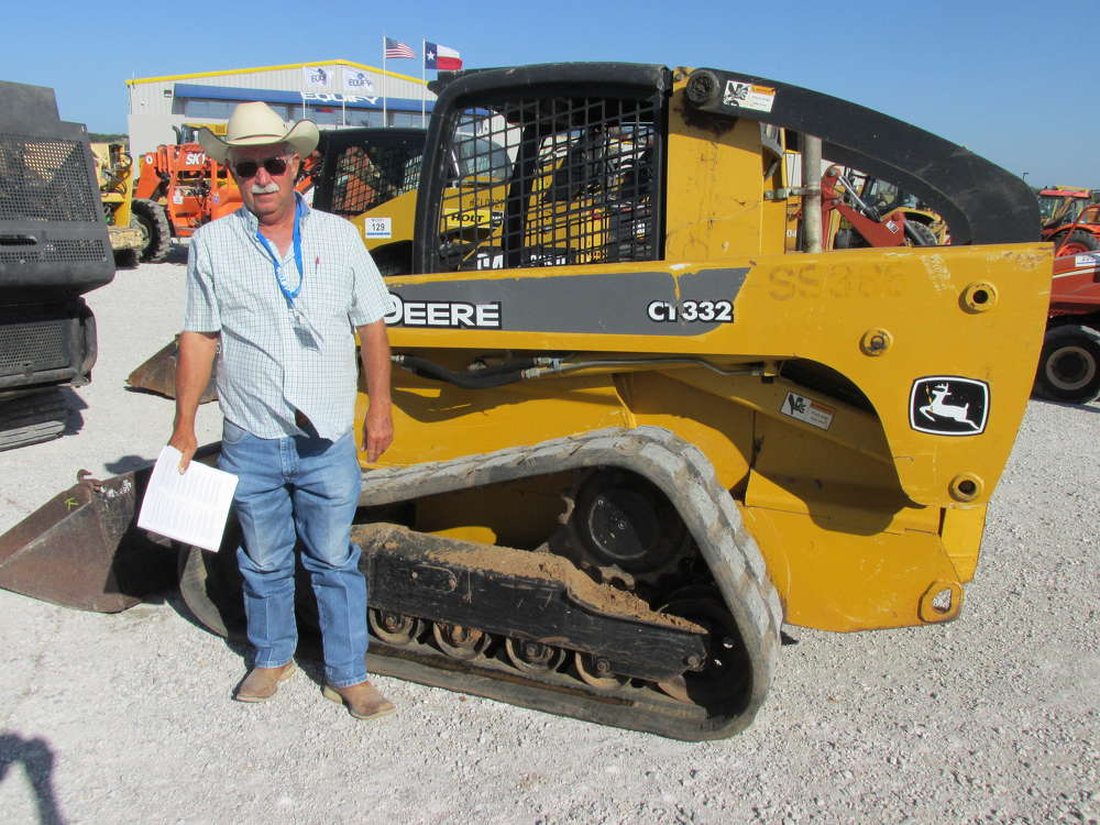 Billy Driskill of All Star Equipment, Rising Star, Texas, has a definite interest in this John Deere CT332 rubber-track skid steer loader.