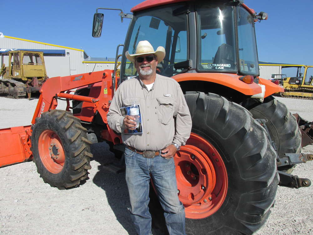 Russell Graham of Graham Ranch, Merkel, Texas, is sure this Kubota tractor is perfect for the project he has in mind on the ranch.