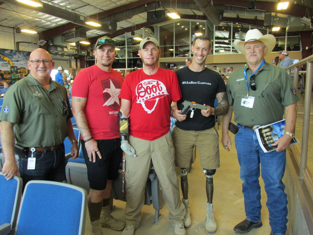 (L-R) are Patrick Hoiby, president of Equify LLC; Hero Ambassador Kelsey Smith, USMC, of Bedford, Texas; Marcus Burleson, USMC bomb squad, of Odessa, Texas; Joey Jones, COO of Boot Campaign, USMC, Georgetown, Texas, holding the Kimber Custom II; and Rand Cupp, USMC, Boot Campaign advisory board, also of R.E. Cupp Construction, Southlake, Texas.