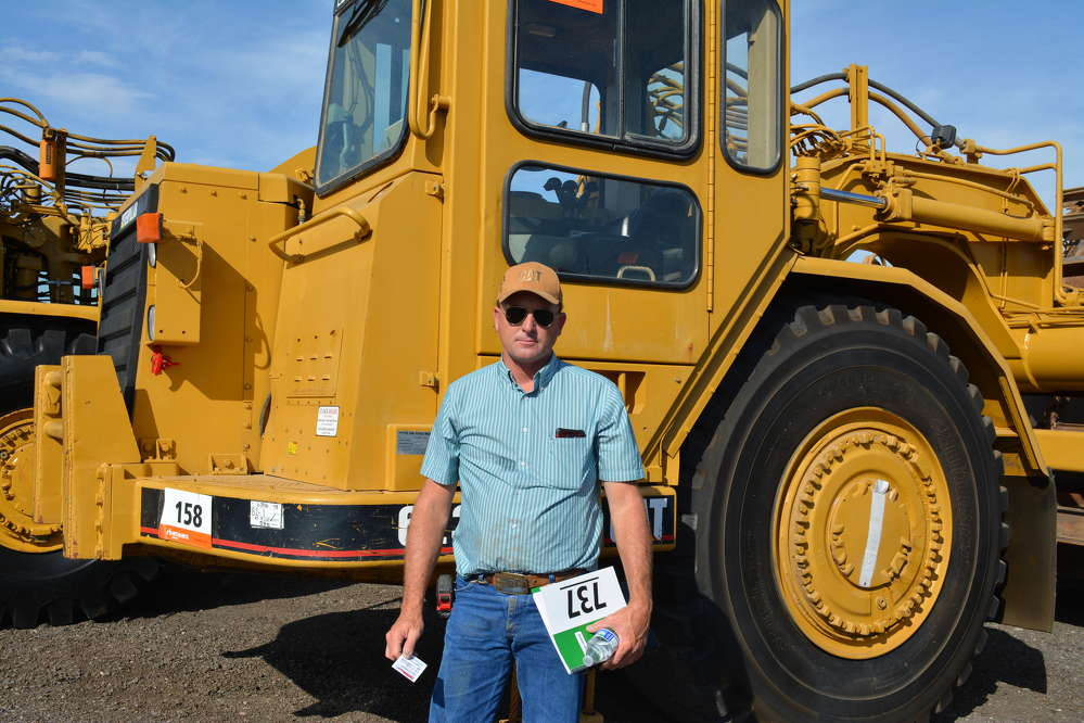 This Cat 623F motor scraper had the attention of Benny Miller of Miller Construction, El Paso, Texas.