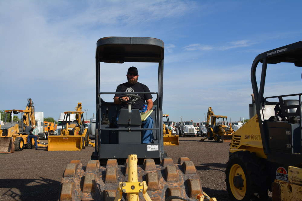 Derrick Czudak of PacWest Rentals, Mesa, Ariz., sits atop a Bomag BW145PDH-3 compactor.