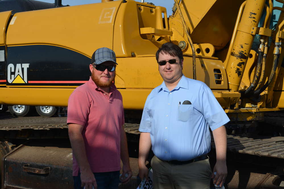 Shohn Huckabee (L) and Raymond Downing of HDW Construction and Drilling were on hand from El Paso, Texas. We caught up with them next to a Cat 330C excavator.