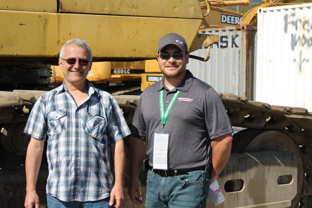 Carlos Monte (L) of McCourt Construction, Boston, Mass., and Todd Merritt, purchasing manager of Equipment 4 Rent, West Bridgewater, Mass., are looking for a good deal on equipment.