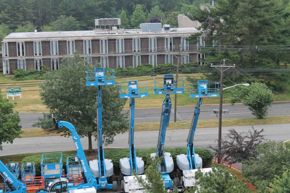 Genie lifts were lined up and ready for new owners during the sale event.