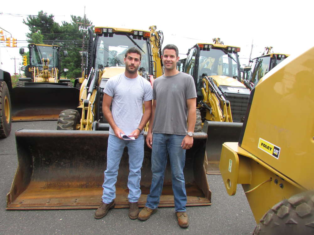 David Stavola (L) and Mike Margiotta, both of Stavola Contracting, Tinton Falls, N.J., are browsing for deals on Caterpillar equipment.