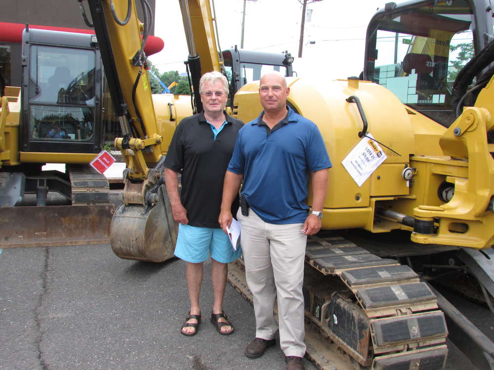 Kevin Flynn (L) and Fred Kurfehs, both of Orchard Holdings, Manasquan, N.J., bought a Caterpillar 305.5 mini-excavator.