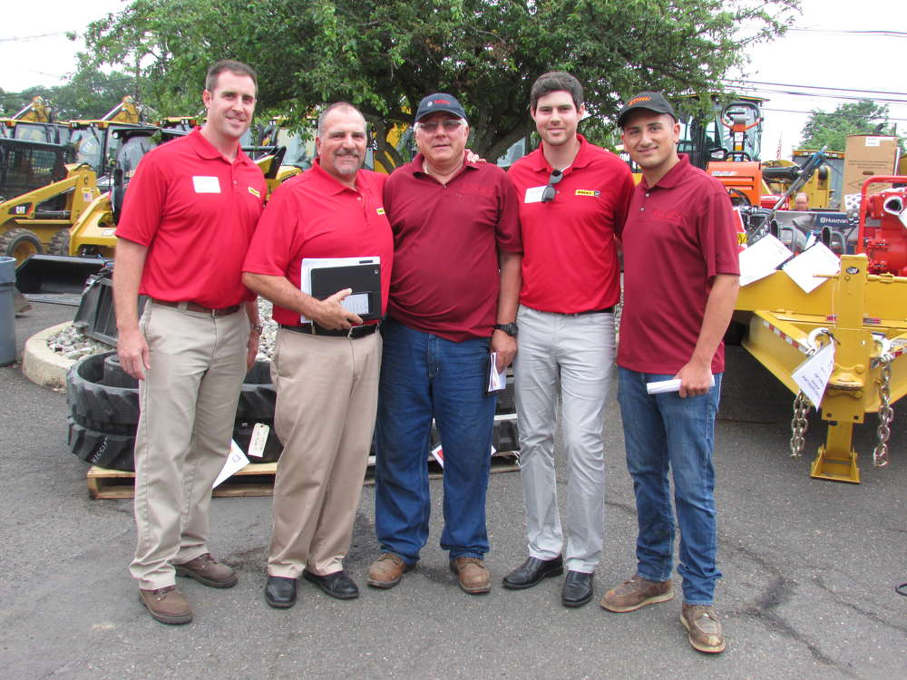 (L-R): Brett Barrett and Tom Alfano, both of Foley CAT; Aldo Perfetto of CPS Contracting, Staten Island, N.Y.; Scott Sarfert, Foley CAT; and Matthew Perfetto, also of CPS Contracting, gather around for a photo and to talk about equipment deals during the One Day Sale.