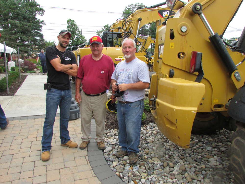 (L-R): Glenn Hisko of Hisko Lowboy, Bridgewater, N.J.; and John and Bill Hisko, both of Hisko Excavating, Somerville, N.J., take a brief break from looking for equipment deals for a photo op.
