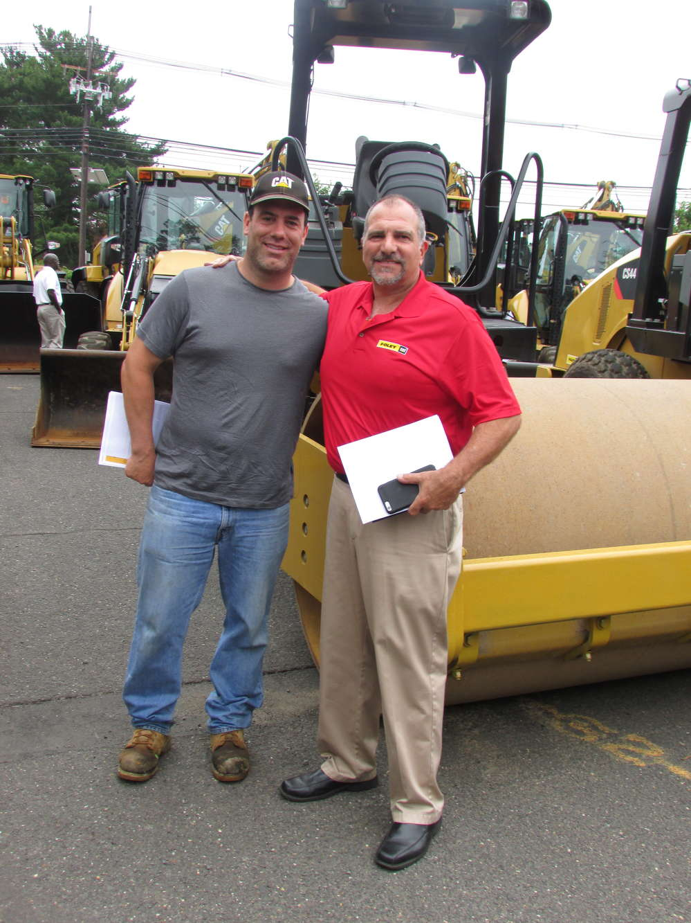 John Holley (L) of Big City Paving, Staten Island, N.Y., and Tom Alfano of Foley CAT. Holley is considering purchasing a Caterpillar 289C2 track skid steer.