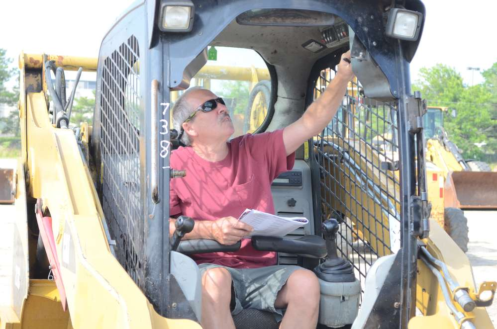 Ed Joyce, owner of Industrial Plant Services, Lester, Pa., is considering bidding on this skid steer.