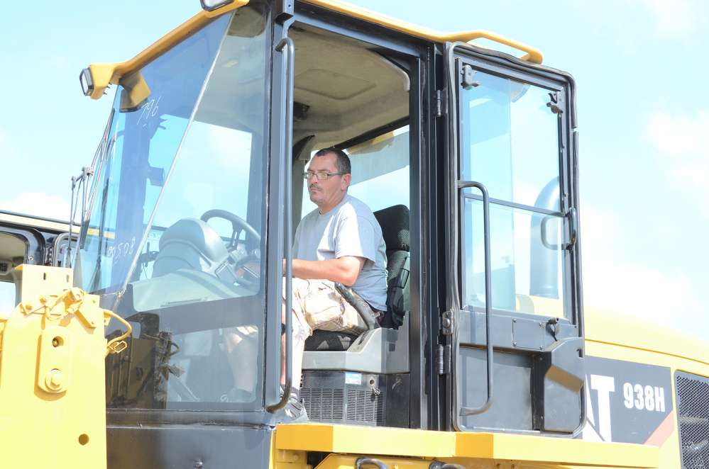 Checking out this Caterpillar 938H wheel loader is Steve Dalbow, business owner in Camden County, N.J.