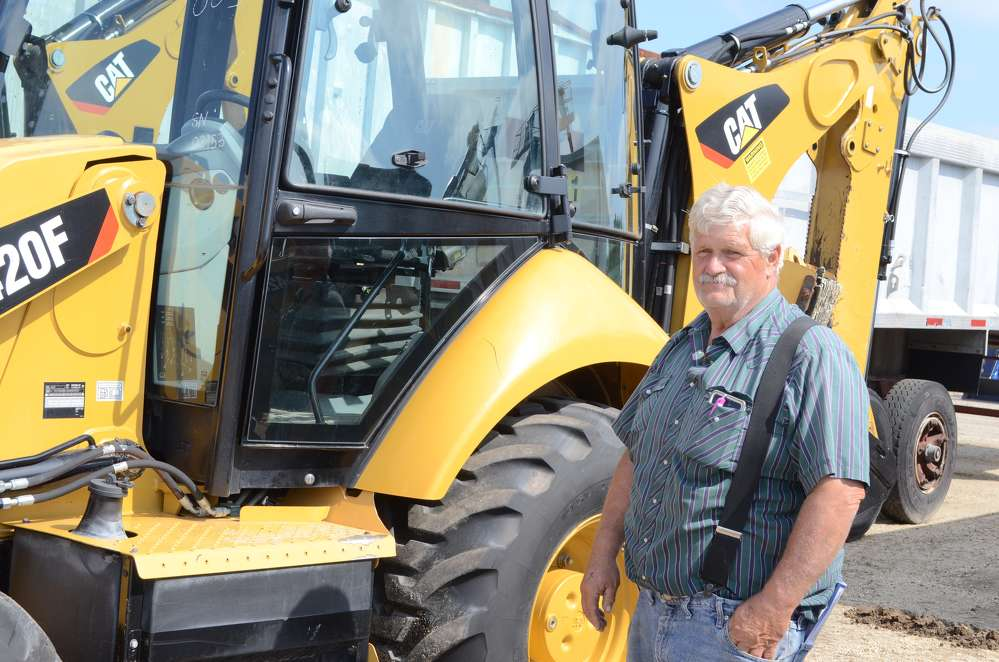Rick Conley, owner of Conley and Sons Excavating, Seneca Falls, N.Y., just finished testing out this Caterpillar 420F backhoe.