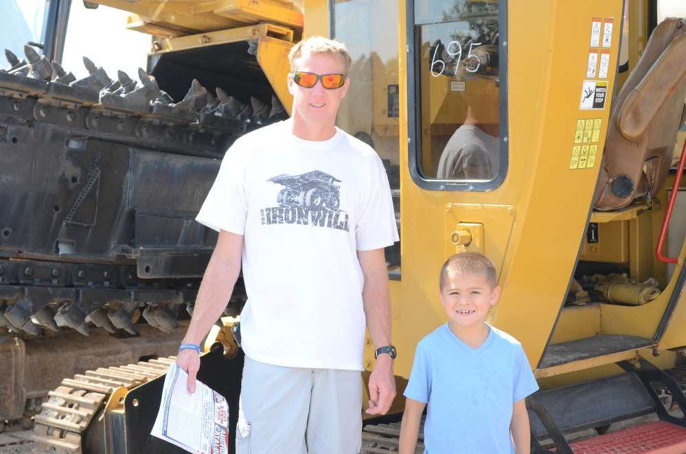 Gene Lewis, owner of Lewis Lawn Service &?Landscaping in Southampton, N.J., and his nephew, Adam, are enjoying the auction.