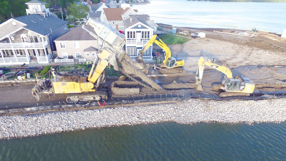 Almost every size of excavator was used from the large Cat 336, an amphibious excavator used in dock removal.