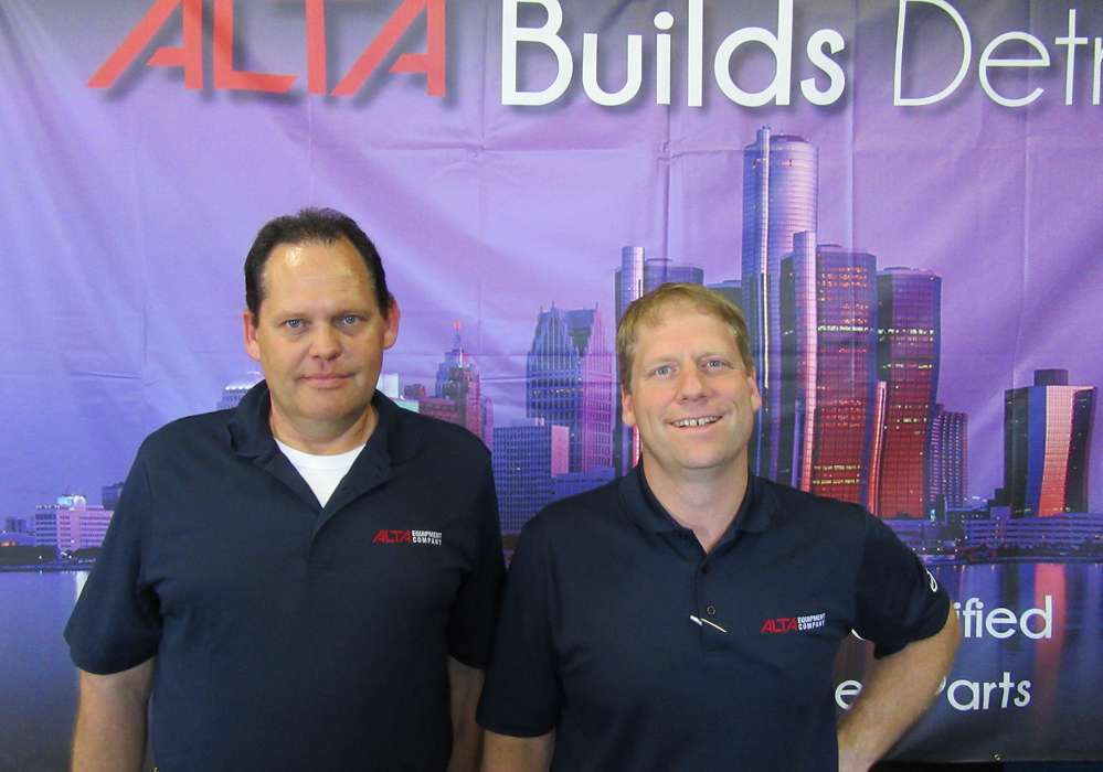 Steve Koval (L), Detroit service manager, Alta Equipment Company, and Kyle Huss, operations manager, take a moment from a busy grand opening schedule.