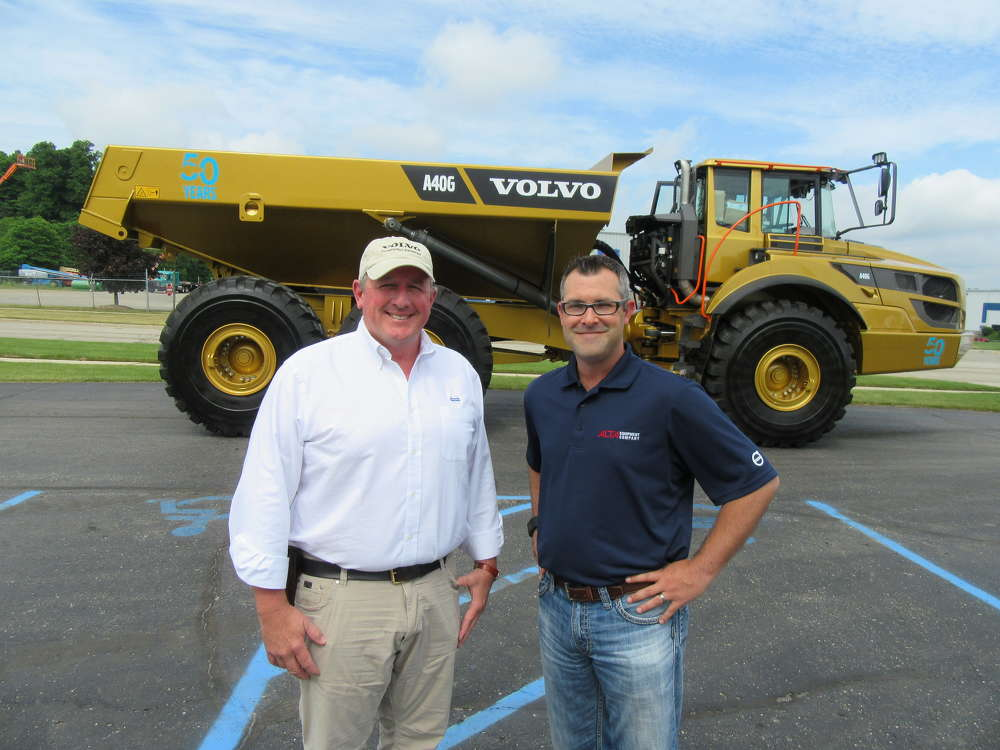 John Waldron (L), district sales manager of Volvo Construction Equipment, stands with Robert O'Rourke, Alta branch manager, in front of Volvo's 50th anniversary A40G Golden Hauler.