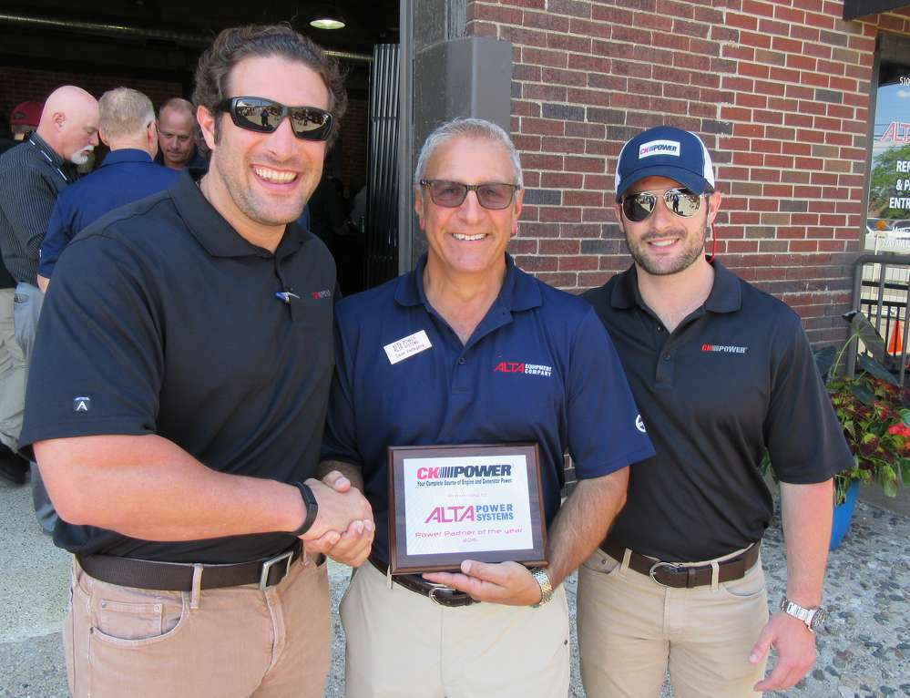 (L-R): JJ Costello and Clayton Costello, both of CK Power, chose the Detroit grand opening to present Dean Pellegata, Alta Power System, with a Power Partner of the Year plaque.