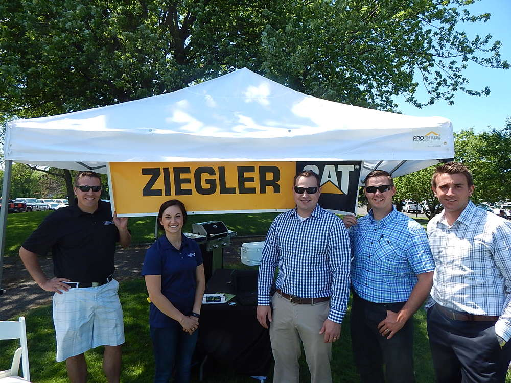 Event sponsor, Ziegler CAT, provided kabobs and refreshments. (L-R) are Luke Magnuson, territory manager, Bloomington,  Minn.; Jenny Covers, advertising event coordnator; Charlie Norgaard, territory manager, Bloomington; Chad Adams, territory manager, Rochester, Minn.; and Bryce Bintzler, territory manager, Minneapolis, Minn.