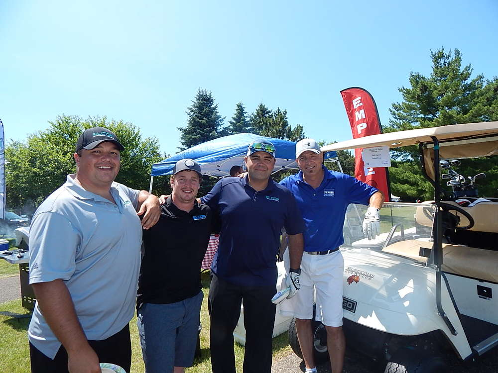 (L-R): Jared Penz, project manager, Nick Carter, project manager, and Cory Penz, superintendent, all of Elcor Construction, and Jeff Bistodeau, territory sales manager, Road Machinery & Supplies, Savage, Minn., enjoy their time at the tournament.