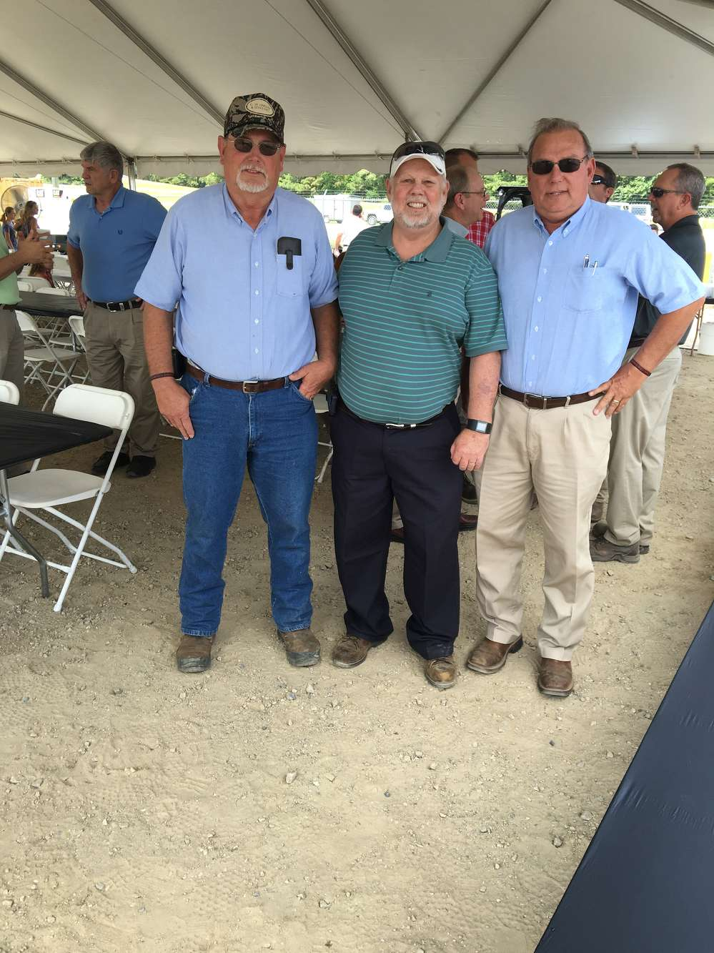 Michael Lindsay (L) and C.M. Lindsay Jr (R), both with C.M. Lindsay & Sons in Lumberton, N.C., congratulate Johnny Parker for his 50 years of service