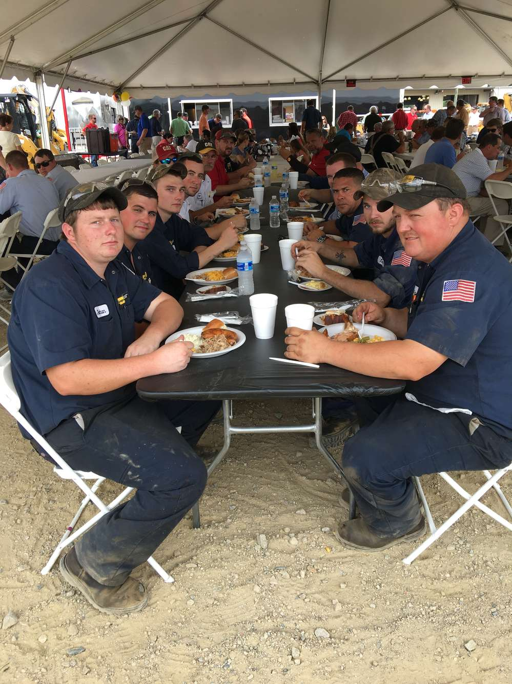 The service technicians take a break to enjoy lunch.