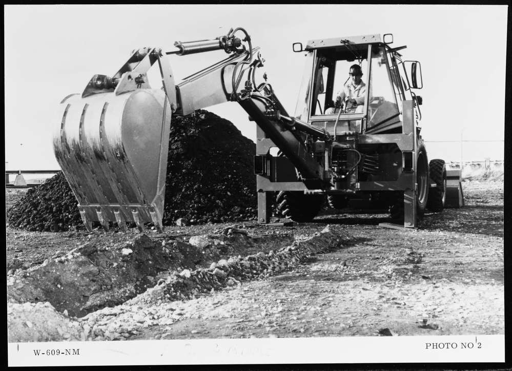 Caterpillar photo. An operator uses the Cat 428BHL to dig a trench in 1986.