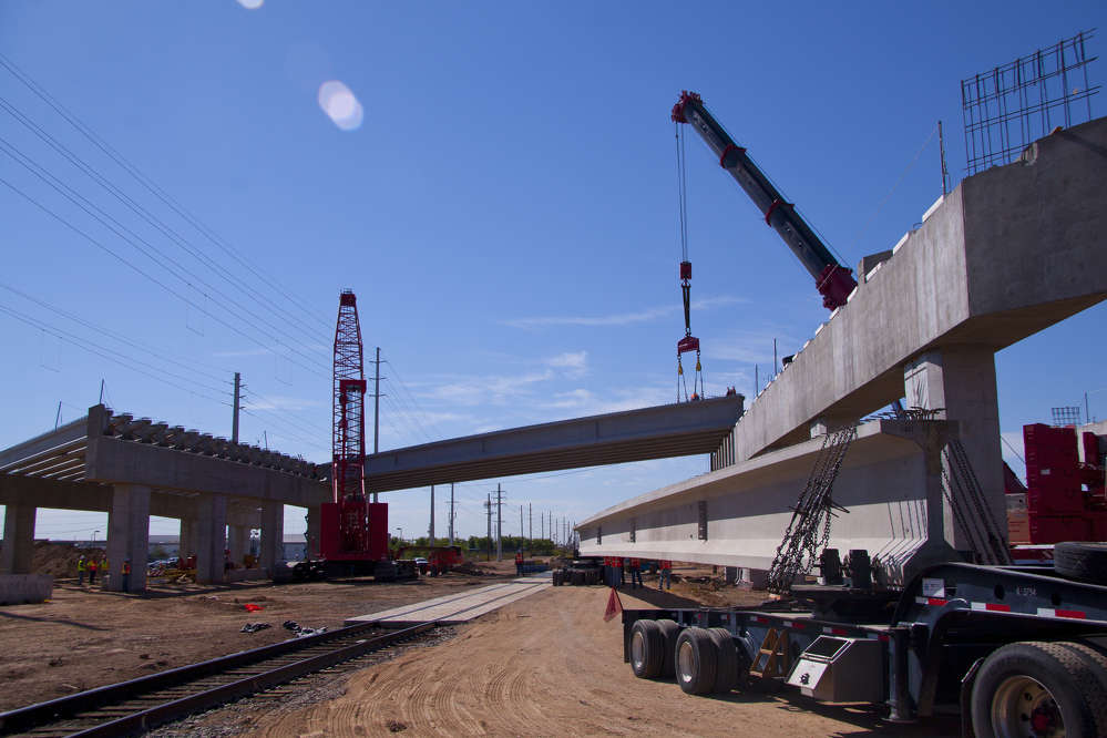 ADOT photo. The overpass is being built over Grand Avenue and parallels Burlington Northern Santa Fe Railway tracks.