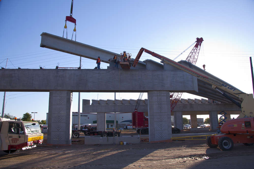ADOT photo. Crews began construction of a new overpass on Bell Road over Grand Avenue (U.S. 60) in Surprise, Ariz., in January.