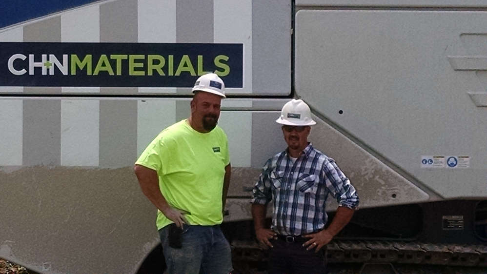 Seth Martin (L), operations manager of materials, and Matt Eshelman, vice president of CH+N Site Construction, stand by their new machine.