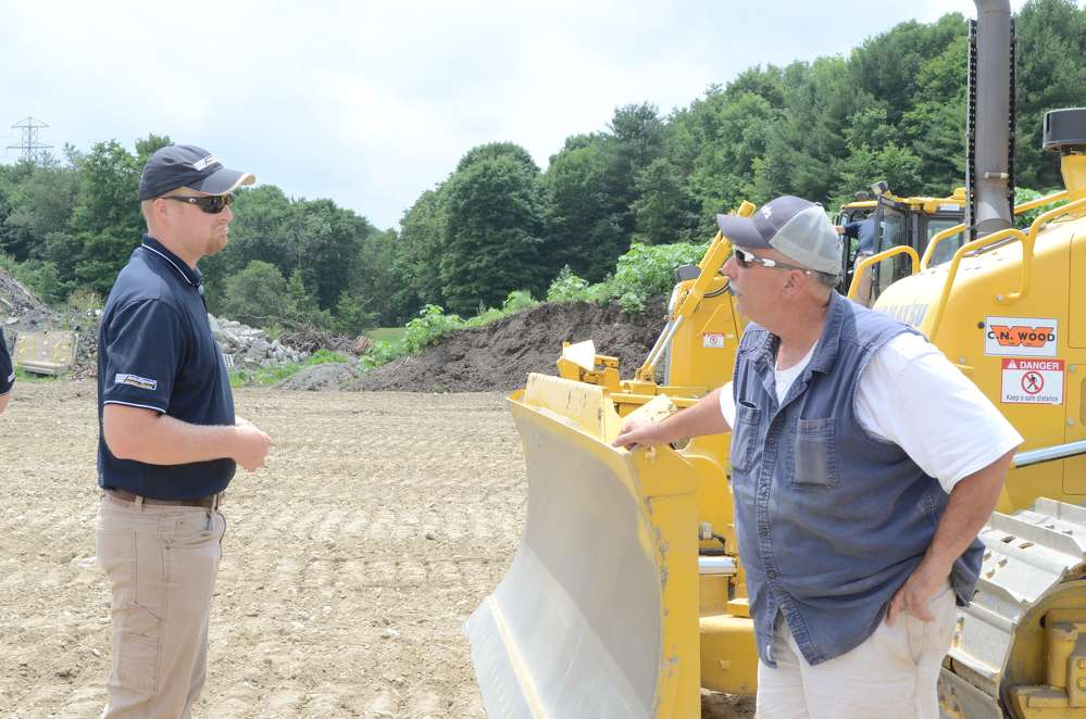 Kevin Schoelkopf (L), technology solutions expert, Midlantic Machinery, talks shop with Mike Volino, vice president, Village Construction Company Inc., Milbrooke, N.Y.