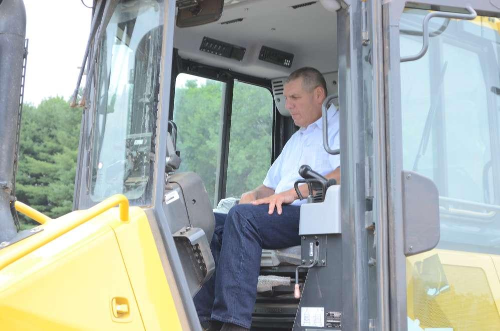 John Borsh of JH Malloy, Lathan, N.Y., checks out the controls.