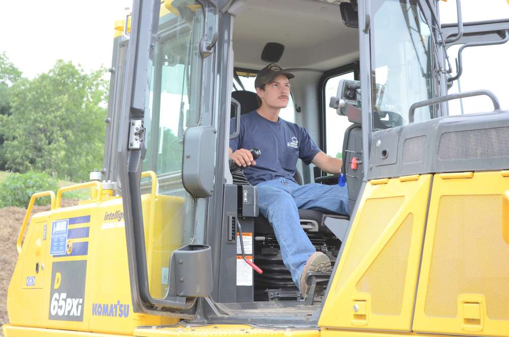 Steve Mosher, R&R Service Center, Stanfordville, N.Y., gets comfortable in the cab of a D65PXi.