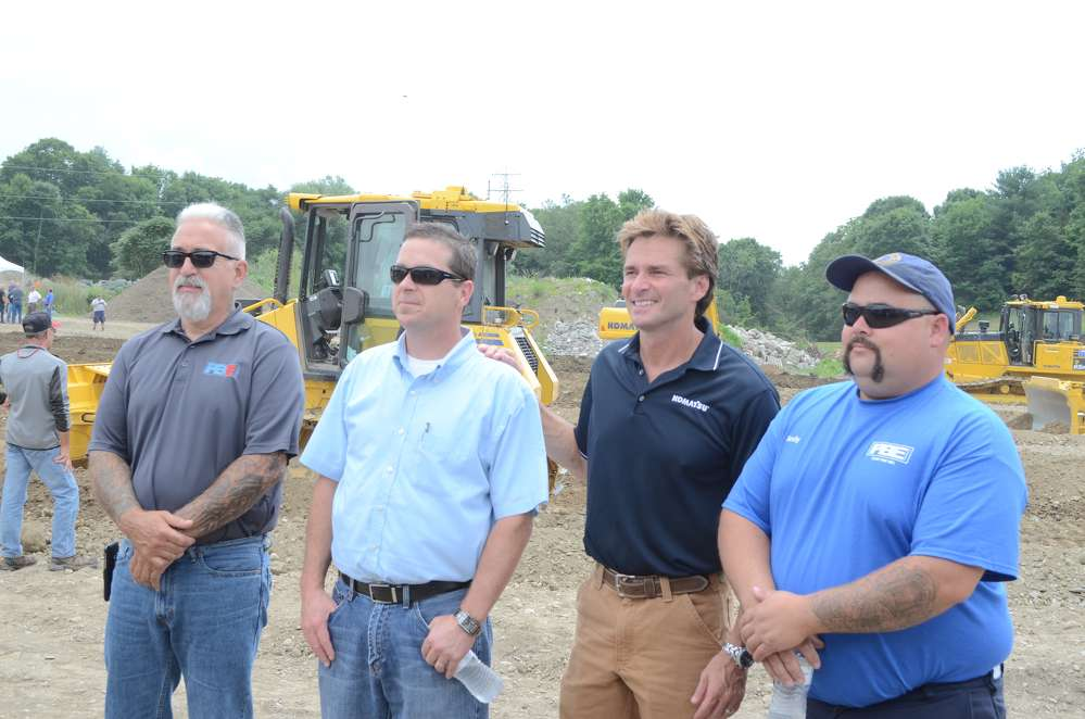 (L-R) are Dan Caruso, rental coordinator, and Kevin Keroack, East branch manager, both of East PBE ; Ed Bowers, Komatsu director of North Region; and Andy Bazzano, East PBE field mechanic.