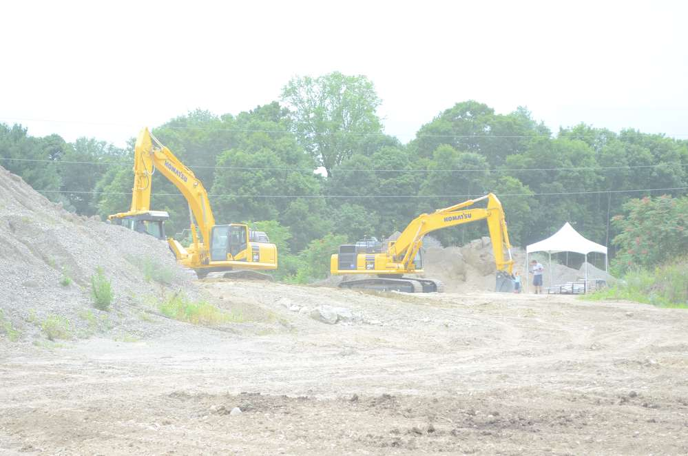 The excavators on display were set up for different scenarios that one might find on a job site.