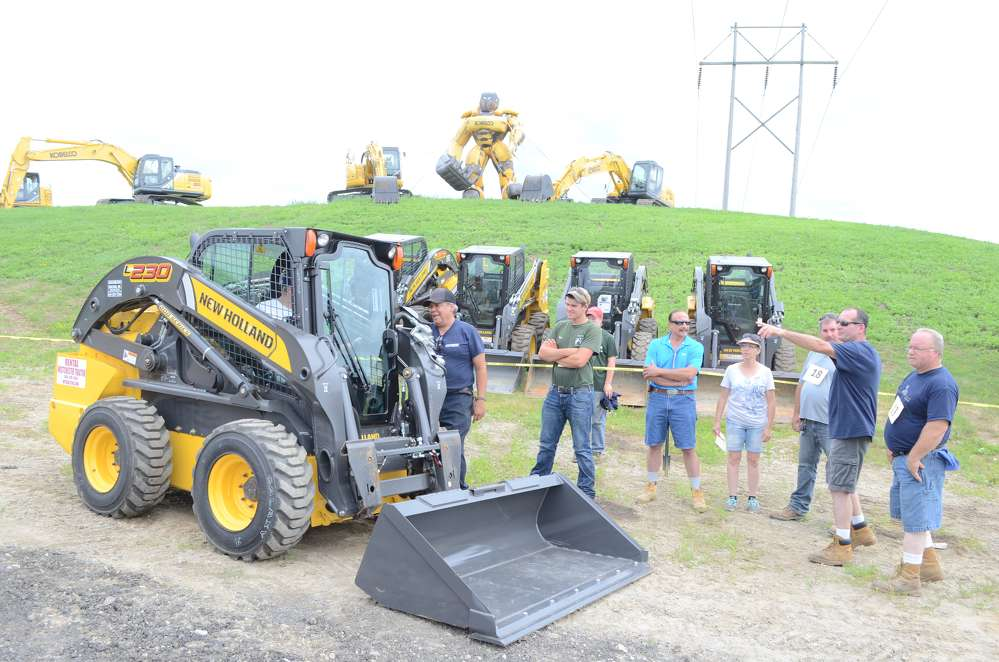 A crowd gathered around the New Holland 230.