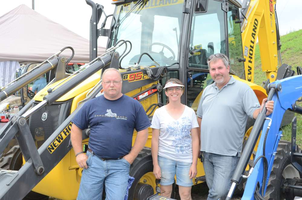 (L-R) are Bob Beeman, public utilities, city of Danbury Water and Sewer department; Lisa Clyne, a local farmer; and Dave Searles, machine operator of Amec Construction, Norwalk, Conn.