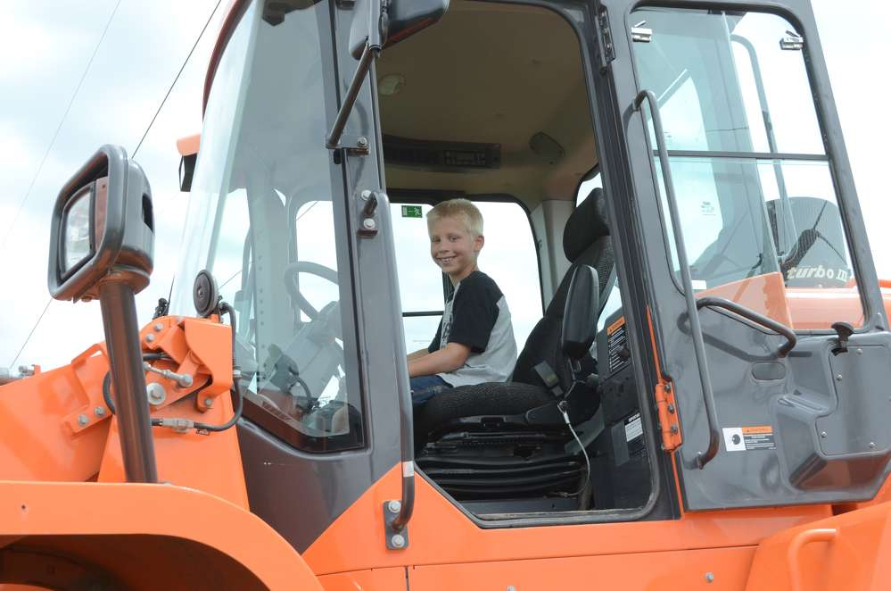 Nate, a huge equipment buff who likes to help out on his grandparents farm in Delaware, heard about the show on the radio and begged his parents to bring him.