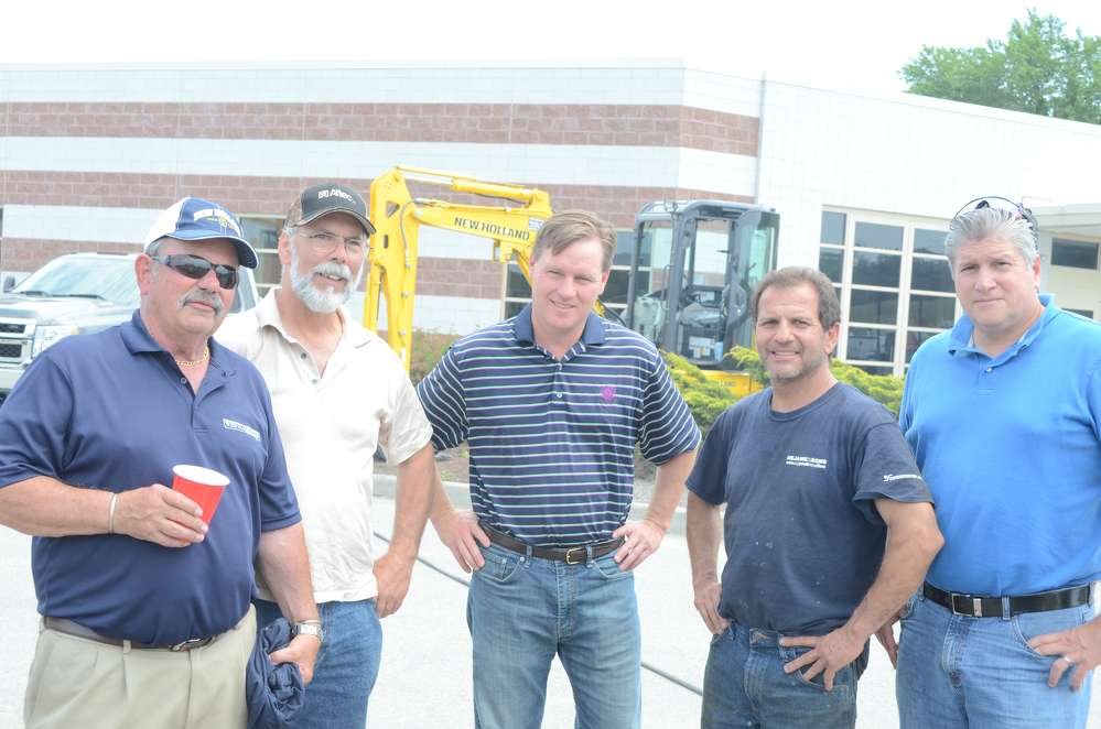 (L-R) are John Apple, owner of Westchester Tractor Inc.; Mike Bruen, highway superintendent of the town of Southeast Highway Department; John Tully, deputy county highway commissioner; Greg Nejame, owner of Nejame and Sons, Danbury, Conn.; and Fred Pena, commissioner of highway and facilities, Button County.