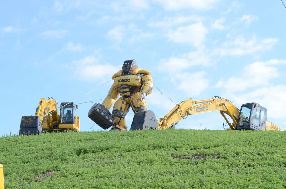 The Kobelco man kept an eye on everyone from atop a hill.
