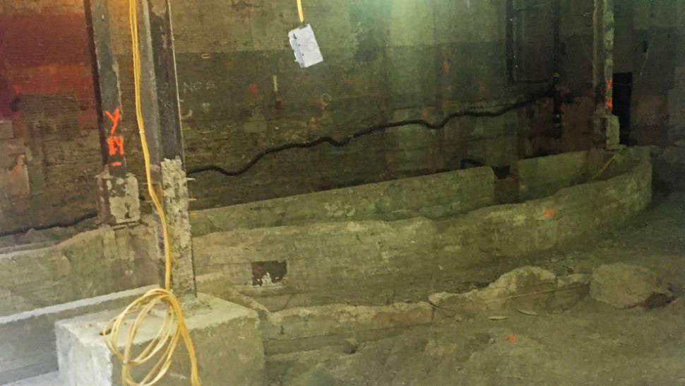 Image courtesy of Playbill. The photo shows the outline of what seems to be an orchestra pit and the edge of a stage.