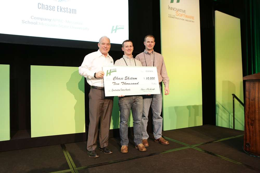 HCSS President & COO, Steve McGough (left), presents the $10,000 scholarship check to Chase Ekstam (center). They were joined by Doug Fronick (right) of APAC-Central, Inc., who supervised Chase during his internship.