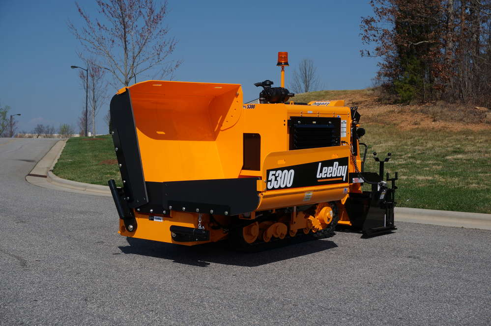 The hopper capacity is 7 tons (6.3 t), which enables the paver to handle the asphalt load of a standard size paver while getting in the tightest of spaces.