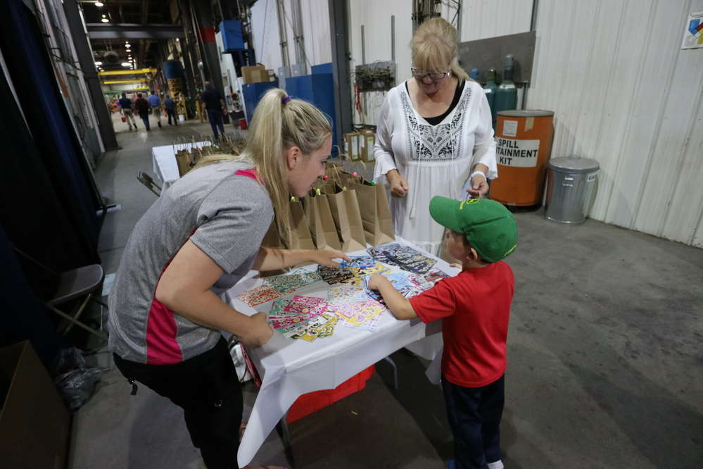 Kids were given gift bags, while employees participated in a drawing for fire pits and gift certificates to Towmaster's parts store.