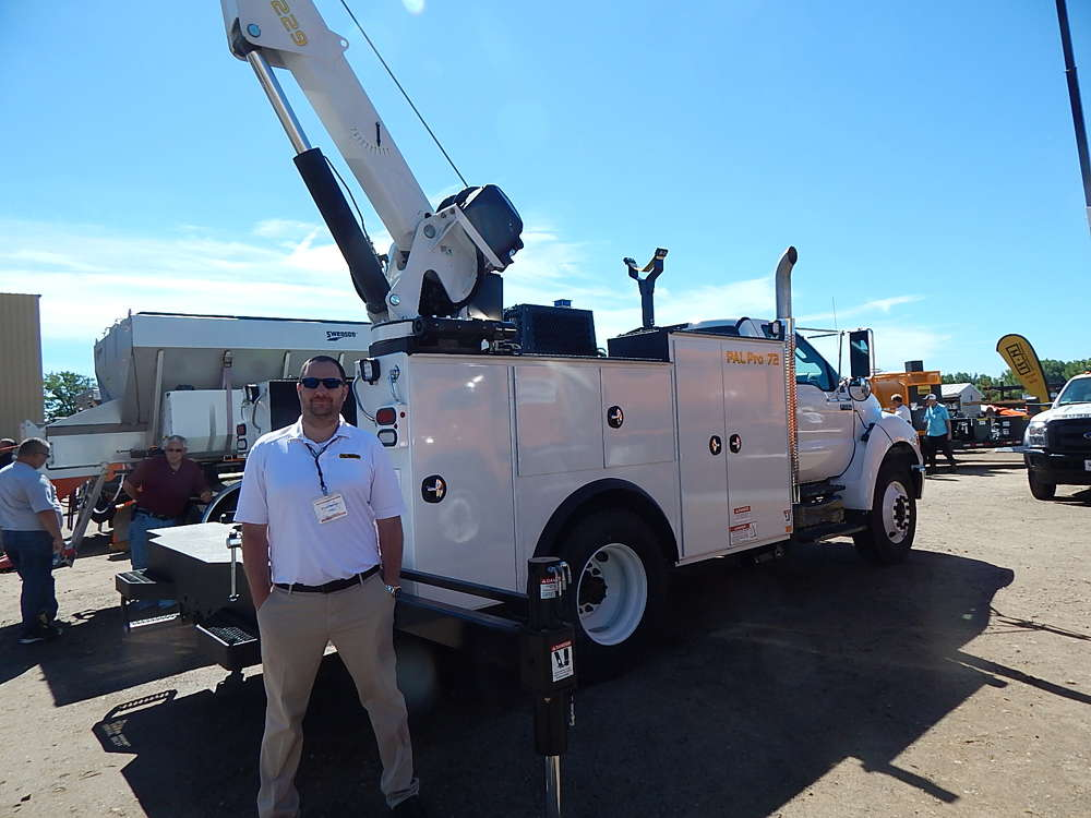 Brian Heffron, national sales manager of Omaha Standard Palfinger, Council Bluffs, Iowa, stands with the Palfinger PAL Pro 72.