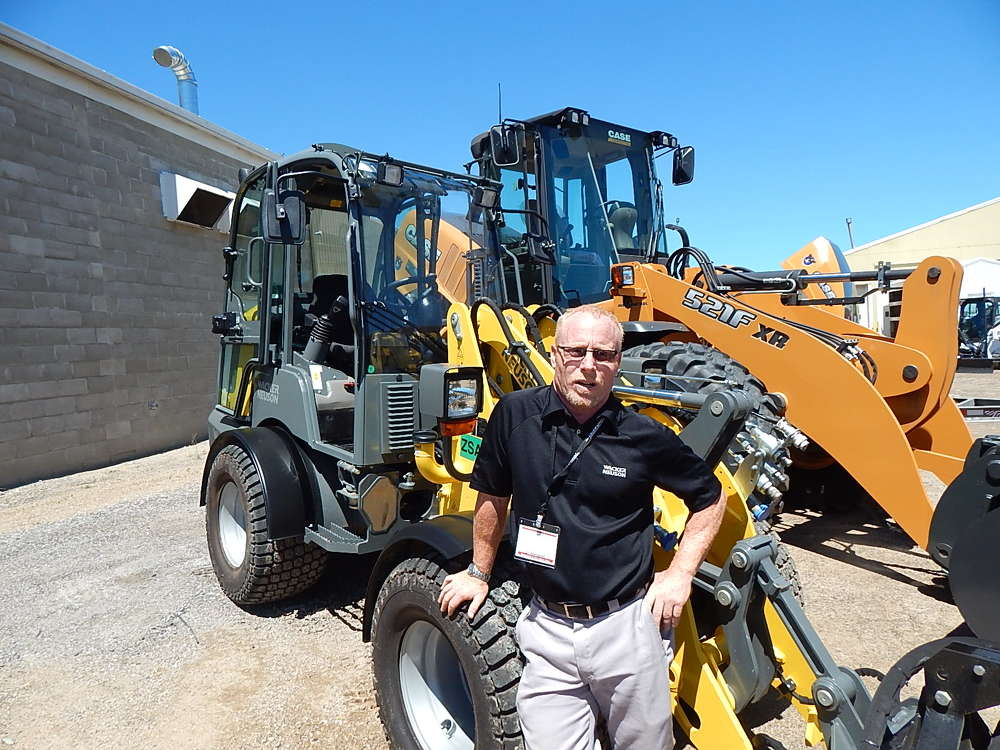 Greg Ramer, Wacker Neuson market development specialist, answers questions about this Wacker Nueson WL32 compact wheel loader at the Titan Machinery display.